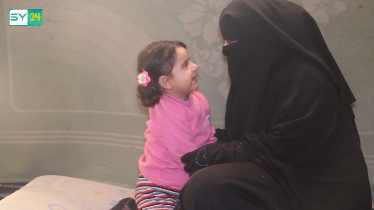 Woman Displaced from Aleppo Takes Care of Orphans
