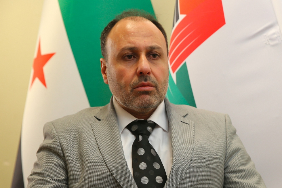Member of the Syrian Coalition's political and legal committees Yasser Farhan